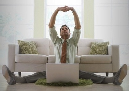man-stretching-with-laptop-1000x300